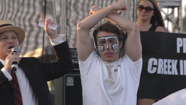 """Tim """"Eater X"""" Janus celebrates after winning the Creek Indian taco eating contest Saturday at Foodabluza."""