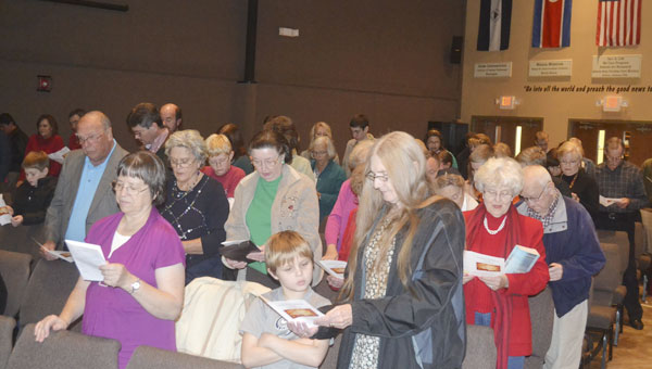 "Worshipers sing ""Amazing Grace"" during Sunday evening's community Thanksgiving service at Grace Fellowship Church."