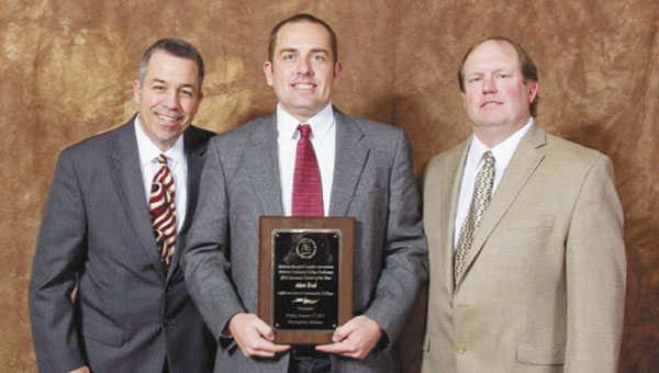 Former JDCC assistant baseball coach Adam Reed, center, recently was named the Alabama Community College Assistant Coach of the Year. Barry Dean, the executive director of the Alabama Baseball Coaches Association, and Lee Gann, a member of the ACBA award committee, presented Reed with the award in Birmingham last week.