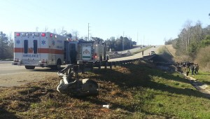 Witnesses said the truck clipped the end of the guard rail before going airborne and landing in the ditch.