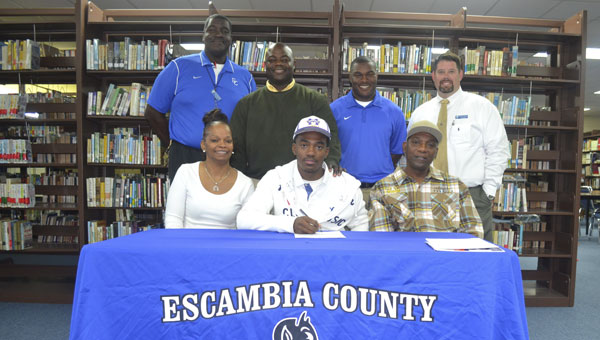Joining Devante Williams at his signing ceremony were: front row, left to right, his mother, Jacqueline Williams, Williams, and his father, Melvin Williams; back row, left to right, ECHS coach Howard Ballard, former ECHS head coach Lev Holly, ECHS coach Fred Moore, and ECHS principal Dennis Fuqua.