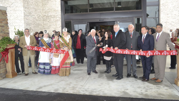 Tribal chairman Buford Rolin and other tribal officials and dignitaries cut the ribbon to open the Buford L. Rolin Health Clinic on Monday morning.
