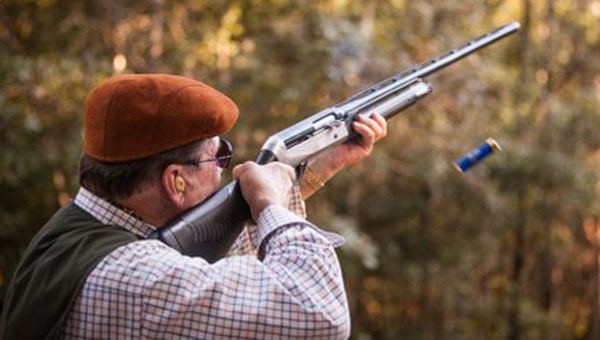 """Event organizers said that a clay shoot tournament is a lot like """"playing golf with a shotgun."""" Competitors have to quickly shoot targets that are released in a variety of heights and movement patterns."""