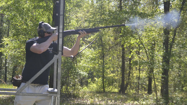 Robert Hardy, of the United Bank team, takes aim at a target during Saturday's first annual Atmore Rotary Club Benefit Clay Shoot.|Photo by Justin Schuver