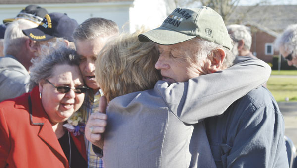 "City council member Susan Smith hugs a Vietnam War veteran during Saturday's ""welcome home"" ceremony at Heritage Park.