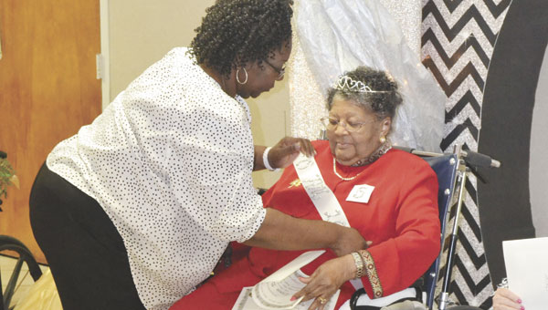 "Angelia Montgomery helps Annie Brazzell put on her ""Miss ANC"" sash, after Brazzell was named the winner of the annual Miss Atmore Nursing Center pageant Tuesday night."
