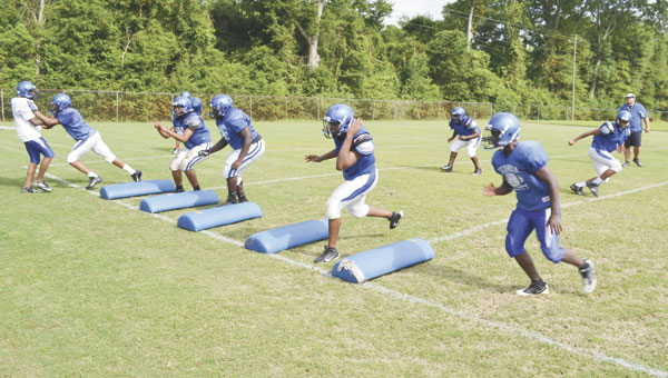 Escambia County High School assistant football coach Al Gilmore watches the defense practice its positioning during a drill Monday afternoon at spring practice. The Blue Devils will play Flomaton and McKenzie on Friday night in a spring jamboree game, at Flomaton High School's stadium. Admission is $6.