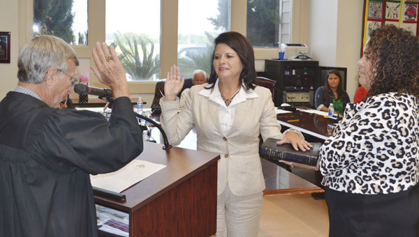New PCI tribal chairman Stephanie A. Bryan recites the oath of office as she is sworn in Thursday by Judge Joe Brogden and Kelli Ramer, PCI tribal council liaison.