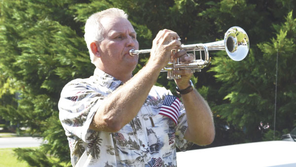 """David Gehman plays """"The Star Spangled Banner"""" on his trumpet during Saturday's Market in the Park in Heritage Park."""