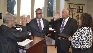Re-elected PCI tribal council members Arthur Mothershed and Garvis Sells are sworn in by Judge Joe Brogden and Kelli Ramer on Thursday.