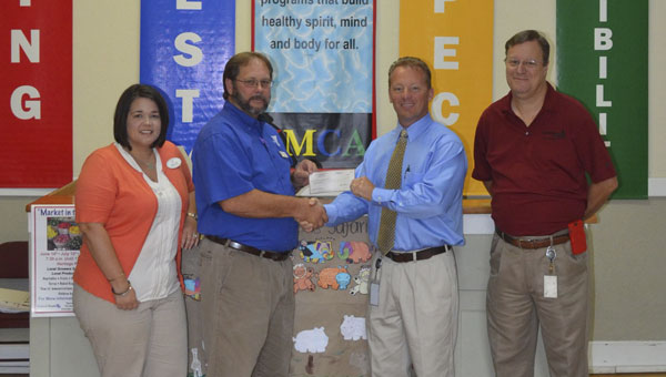 Paul Chason, CEO of the Atmore Area YMCA, received a $10,000 grant Friday from Alabama Power Company to improve the YMCA's air conditioning systems. Shown are, left to right, YMCA board member Kellie Odom, Chason, Lee Hall with Alabama Power Company, and Ricky Martin, YMCA Board of Directors chairman and manager of Alabama Power Company in Atmore.