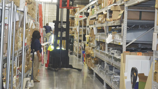Walmart employees work in the back stocking area of the store Monday morning.