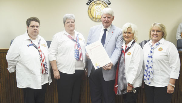 Atmore Veterans of Foreign Wars Post 7016 Auxiliary members joined Mayor Jim Staff on Monday as he signed a proclamation declaring the city's support of POW/MIA Day. Shown are, left to right, Jenny Hutto, Gayle Johnson, Staff, Debbie Thornton and Ginger Stabler.