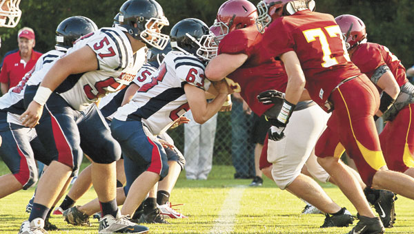 EA players try to break through the Deerfield-Windsor line during a scrimmage earlier this year. Photo by Ditto Gorme