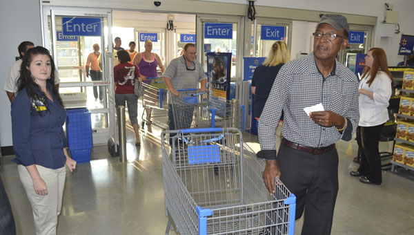 Shoppers enter the store shortly after its official opening Wednesday.