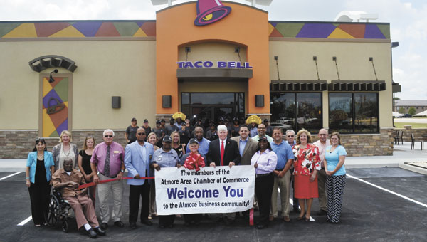 Atmore Chamber officials, city government members and Taco Bell staff celebrate as the restaurant joins the Atmore Area Chamber of Commerce. Taco Bell opened for its first day Wednesday, Aug. 13, at 7 a.m.