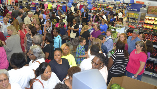 Shoppers anxiously await the opening of Atmore's new Walmart on Wednesday morning.