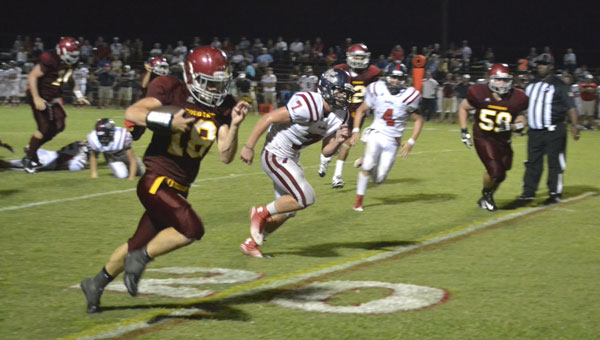 Escambia Academy running back J.P. Sawyer breaks away for a 30-yard touchdown run in the third quarter Friday night. EA defeated visiting Fort Dale Academy, 54-12.