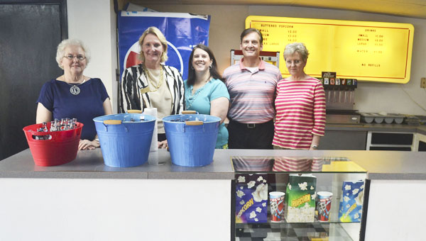 The Pride of Atmore, a community organization, recently completed the purchase of the old Strand Theater. They hope to use it for community events. Shown in the lobby are, left to right, Pride of Atmore members Nancy Karrick, Sheryl Vickery, Missie Tschida, Bub Gideons and Nancy Helton.