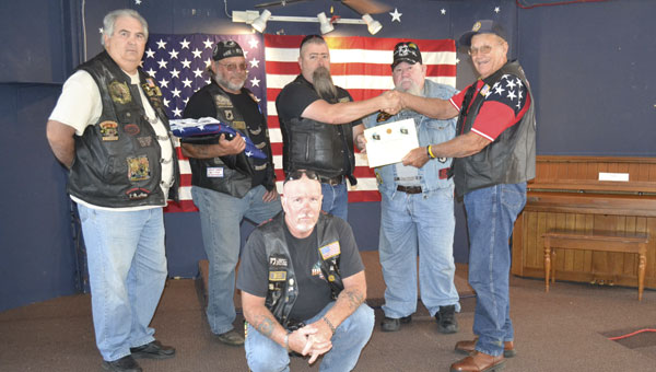 Members of the American Legion Riders present Jimmy Kilcrease (an Atmore member of the American Legion Riders) with a certificate commemorating Tuesday's ceremony. Shown are: back row, left to right, Steven Quinn, Bill Kilde, Scott MacDougal, Butch Dennis and Kilcrease; front row, kneeling, Bill Ward.