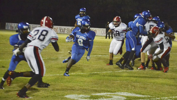 ECHS junior running back Gaetyn Thames runs through a big hole in the Blue Devils' 58-20 loss to visiting T.R. Miller on Friday night.