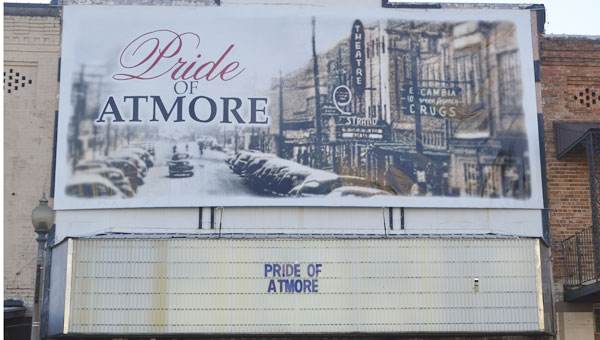 A new poster and marquee message are now visible outside the Strand Theater.