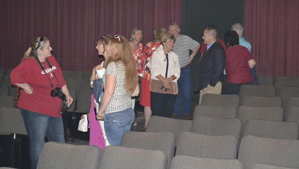 Citizens visited the theater Monday for a ceremony celebrating its purchase.
