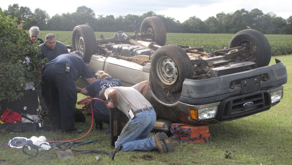 First responders work at the scene of a fatal accident Friday afternoon off Robinsonville Road.|Photo by Allison Brown