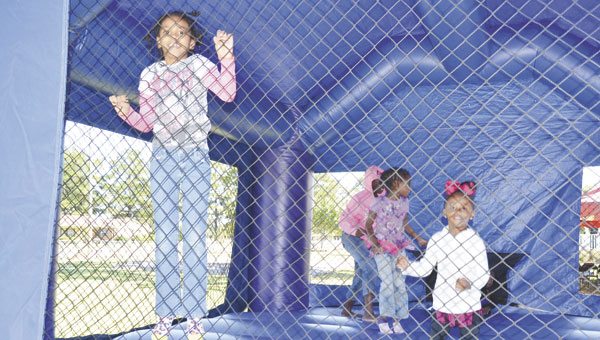 """Youngsters have fun in the """"bouncy castle"""" at Saturday's Stomp the Yard event."""