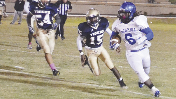 ECHS running back Gaetyn Thames breaks away from Monroe County defenders on Friday night. Thames scored four touchdowns as the Blue Devils won their first game of the season, beating the Tigers by a 42-30 score.