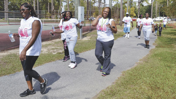 Participants in the Women of Distinction's annual cancer awareness walk made several laps at Tom Byrne Park on Saturday, as a sign of their solidarity against cancer.