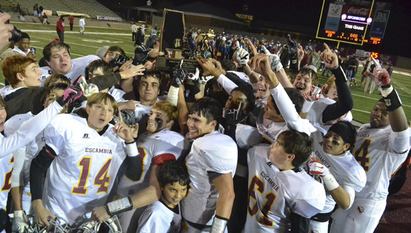 Escambia Academy players celebrate their victory over Bessemer Academy in the AISA Class AAA championship game.