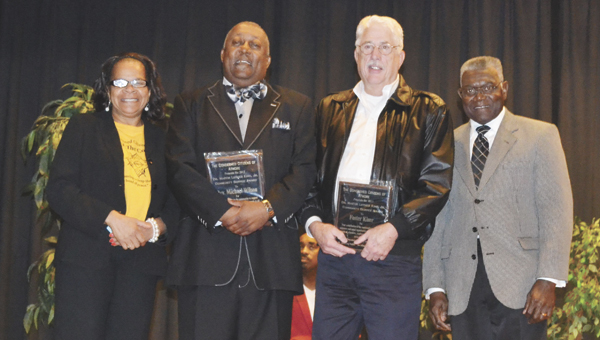 Dr. Michael Wilson Sr. and Foster Kizer received MLK Community Service Awards. Shown are, left to right, Sandra Gray, Wilson, Kizer and Dr. Coleman Wallace.