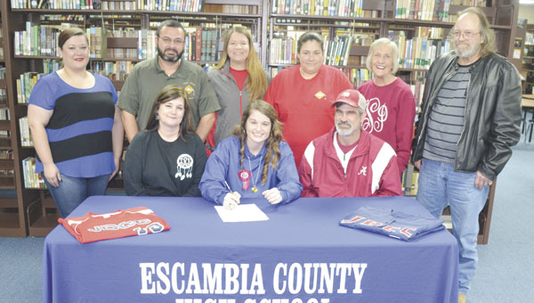 ECHS senior Kaylee Cox announced Friday that she will play softball at Jefferson Davis Community College. Joining Cox for the signing were: front row, left to right, her mother, Theresa Rutherford; Cox; and her father, Donnie Cox; back row, left to right, ECHS softball coach Stephanie Adams; her stepfather, Chris Rutherford; JDCC coach Misti Nims; her stepmother, Wendy Cox; her grandmother, Nancy Smith; and her grandfather, Walter Sessions.