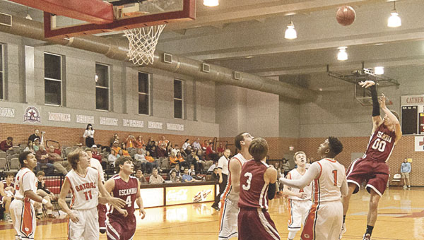 Blake Allen takes a shot for Escambia Academy against Glenwood. Photo by Ditto Gorme, For The Advance