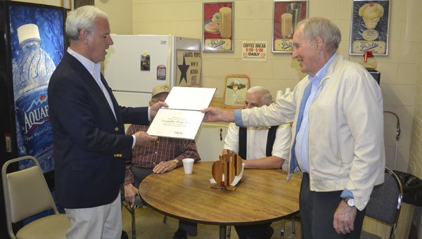 U.S. Rep. Bradley Byrne presents Escambia Drug Store owner Kenneth Barnett with a Certificate of Special Congressional Recognition, honoring the business's more than 103 years of service.