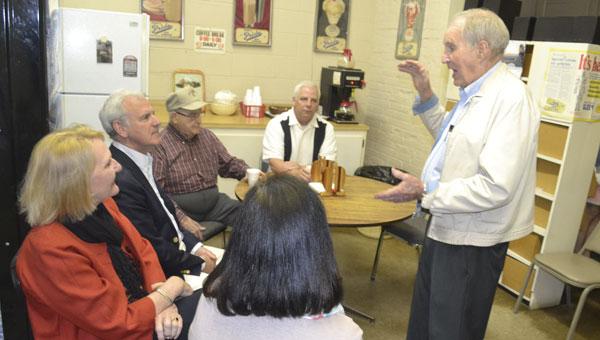 Kenneth Barnett talks about Escambia Drug Store's long-gone soda fountain. Listening are, clockwise from Barnett, Marshall Rogers, Sheryl Vickery, U.S. Rep. Bradley Byrne, Giles Chapman and Tom Tschida.
