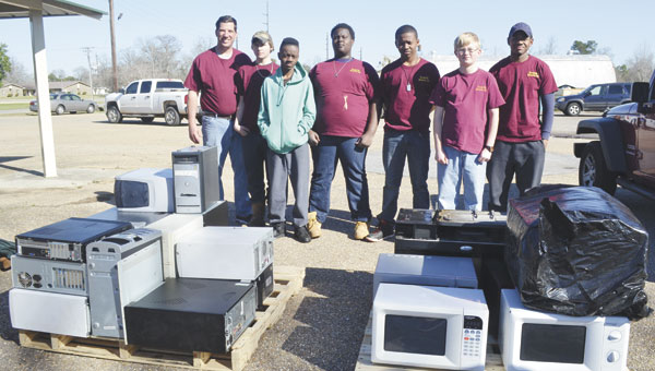 Members of the Boy Scout Troop 26 in Atmore assisted the city with its electronics recycling drive Saturday morning.