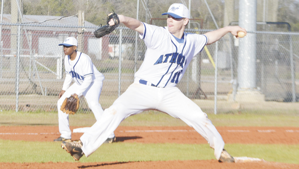 Escambia County High School pitcher Tanner Smith delivers a pitch against Flomaton on Friday, while third baseman Jabryce Hooks gets in defensive position. Smith struck out 10 batters in four innings, in the Blue Devils' 3-1 loss.
