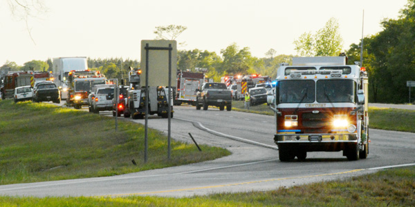 Traffic was halted in both directions as first responders worked at a nine-vehicle crash on Interstate 65 near Exit 69 Thursday evening. One is confirmed dead and six more people were injured.|Photo by Stephanie Nelson, For The Advance