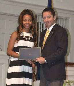 ECHS senior Christin Simpkins received the $2,000 Mary Joyner Grissett Memorial Scholarship. Rotarian Allen Walston presented the scholarship to Simpkins.