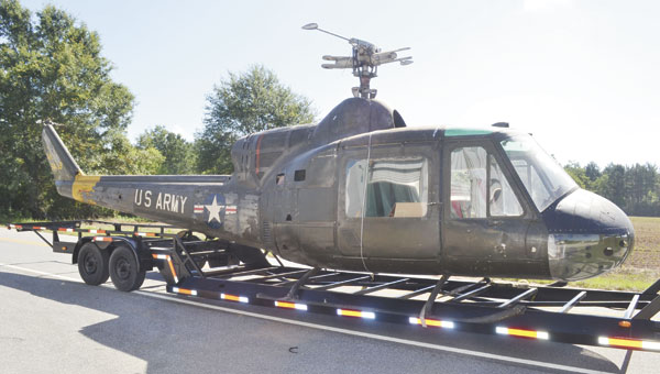 """Blast-Off, Inc., employees transported this classic U.S. Army XH-40 helicopter from Fort Rucker to their headquarters near Atmore Municipal Airport on Tuesday. They will spend the next year restoring it to its original glory. This helicopter was a prototype that eventually led to the creation of the famous """"Huey"""" helicopter."""