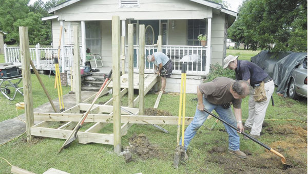 en's club members Buck Farrior, Burrell Jerkins, Butch McKenzie, Durwood Mantel and Mike Edwards build a ramp for an Atmore resident in May.