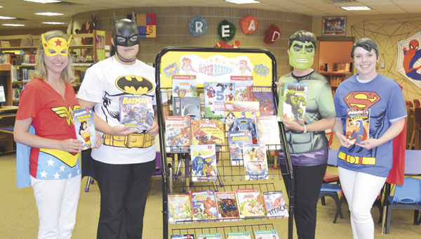 Famous superheroes Wonder Woman, Batman, the Hulk and Superman show off some of the Atmore Public Library's children's books for the summer reading program.