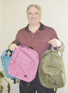 Wendell Ray shows off some of the backpacks.