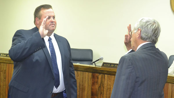 Municipal judge Joe Brogden, right, swears in Chuck Brooks as Atmore's new police chief at Monday's city council meeting.