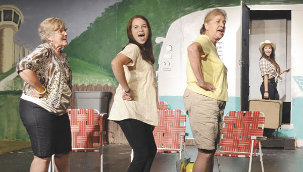 """Betty (Sharon Poulsen), Pickles (Melissa Wilson), Lin (Gilda Stubben) and Pippi (Emily Danforth) sing about living on the """"Right Side of the Tracks."""""""