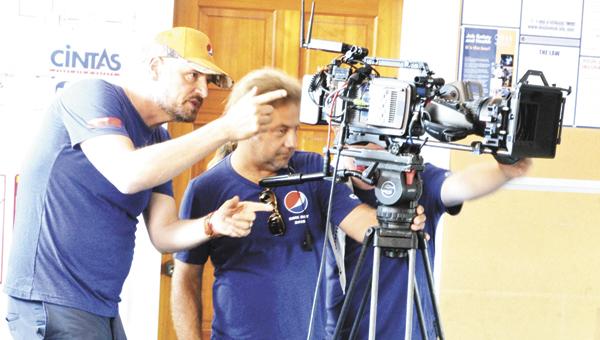 Justin Schuver/BNI News Service Director Matti Leshem instructs cameraman Andrea Rossotto.