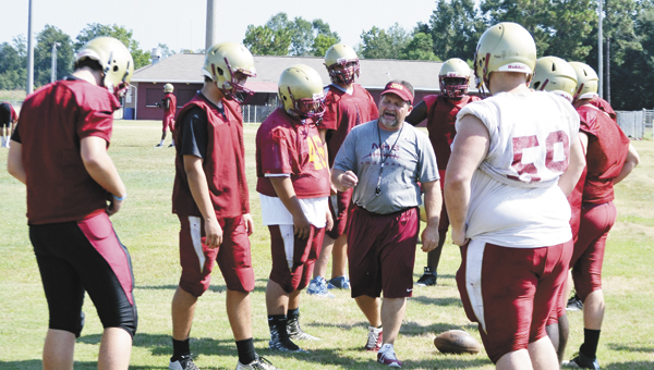 Justin Schuver/The Atmore Advance | Northview offensive/defensive line coach Glenn Weber gives out instructions during a drill with the linemen.