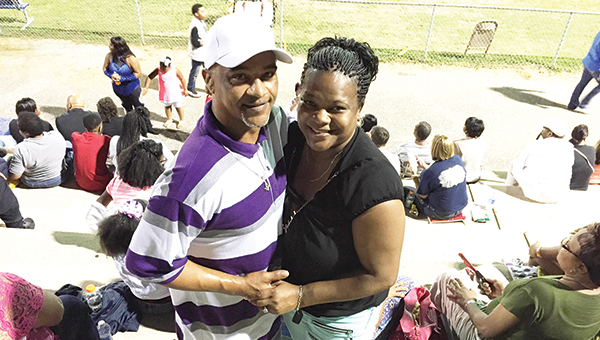 Linda Richardson (right) and Mike Wiggins pose for a picture right after they got engaged last week at Escambia County's football game.   Andrew Garner/The Atmore Advance